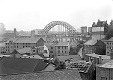 A view looking south-west over rooftops from Pandon Bank towards the new Tyne Bridge, Gateshead, Tyne and Wear, UK - ARC105385