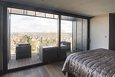 Master bedroom with panoramic view towards East London of a refurbished top floor flat of a large detached Victorian property and attic conversion inc... - ARC105679