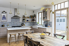 Dining table in the kitchen of a redesigned and remodelled family home in West London, UK - ARC105821