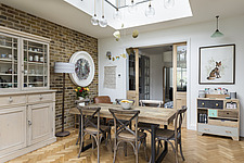 Dining table in the kitchen of a redesigned and remodelled family home in West London, UK - ARC105823