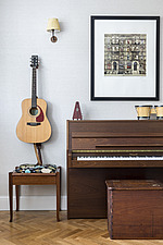 Piano and guitar in the living room of a redesigned and remodelled family home in West London, UK - ARC105829