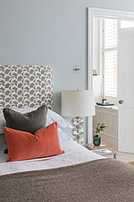 Cushions on a bed in a refurbished apartment in Hove, East Sussex, UK - ARC105844