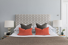 Cushions on a bed in a refurbished apartment in Hove, East Sussex, UK - ARC105845