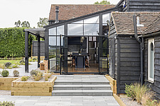 Exterior view of a converted barn/mill in Essex, UK, featuring beautful steel windows - ARC105867