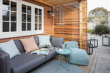 Outdoor seating area of a renovated house by the sea in Hampshire, UK - ARC105871