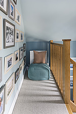 Pouffe and cushion on the landing of a renovated house by the sea in Hampshire, UK - ARC105876
