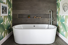 Freestanding bath in the bathroom of a renovated house by the sea in Hampshire, UK - ARC105877