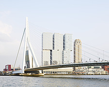 Exterior of De Rotterdam in Rotterdam, The Netherlands, with Erasmus Bridge in the foreground - ARC105916