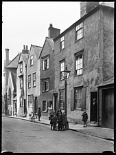 A view of 17th and 18th century houses on the north side of Beef Lane, Oxford, showing the fronts of numbers 4-8 from the south-west, with children in... - ARC107495
