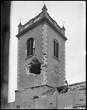 A view from the window of the Church Institute showing air raid damage to the tower of St John's Church, Birmingham - ARC108183