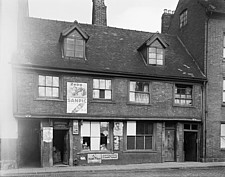The front elevation of 84-85 Little Park Street, premises of Ladkins Tobacconists Shop, with the entrances to Court 18 and Court 19 visible on either... - ARC108184