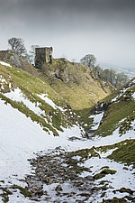 General view looking north-east from Cave Dale towards the keep of Peveril Castle after light snowfall - ARC108194