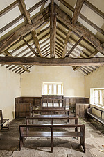Interior view of the meeting house, showing its timber roof structure and seating - ARC108195