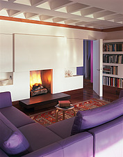 Lone Oak Hall, East Sussex - oblique view of lounge with lit fire - 9657-310-1